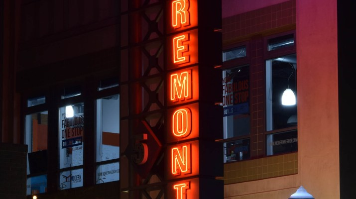 "A movie theater has a ""Laemmle's Claremont"" sign."