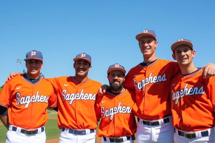 Four Sagehen baseball players smile with their arms around one another