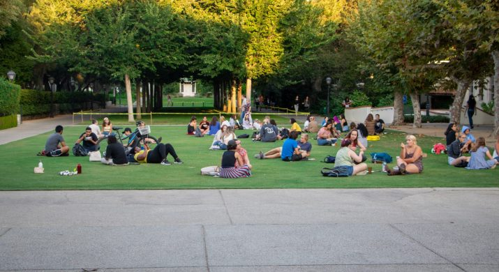 Students sit on a lawn at Scripps College