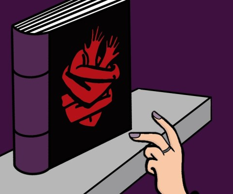 Hand reaching for a book