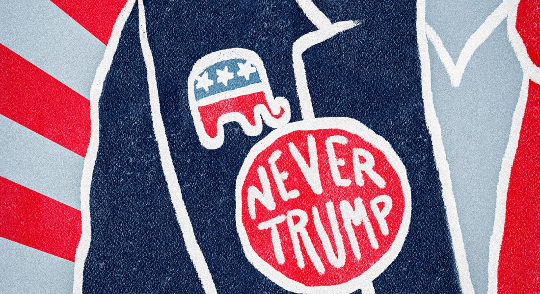 """A man in a suit with a button titled, """"NEVER TRUMP"""" with the republican elephant symbol"""