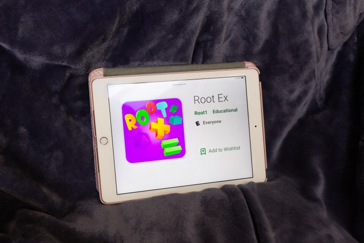 An iPad open to the Google Play Store listing of the Root app.