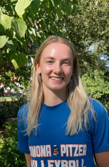 Paige Wilson smiles wearing a Pomona-Pitzer volleyball team shirt.