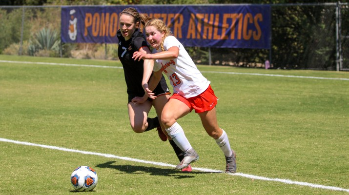 A Pomona-Pitzer women's soccer player compete for the ball with an Occidental player.