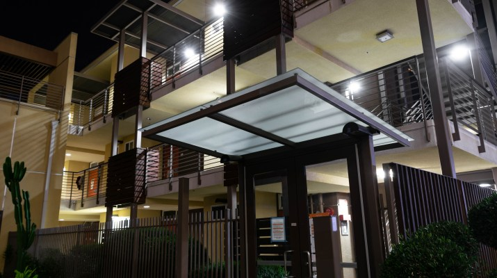A three-storey college residential hall at night.