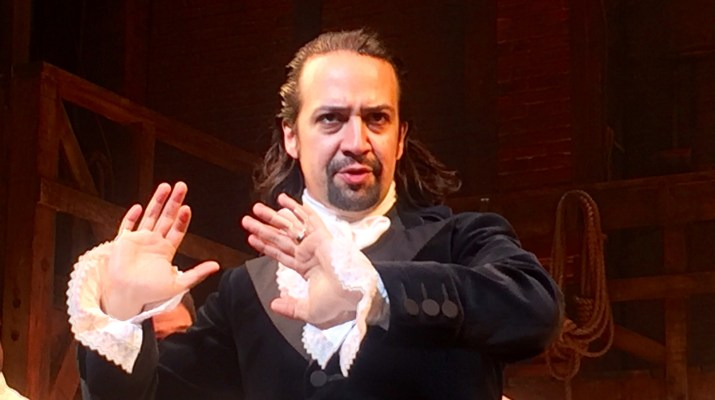 Lin-Manuel Miranda acts on stage.