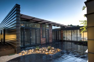 Industrial House - central courtyard after rain - private open space between two living areas