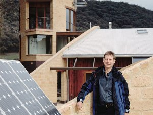 Autonomous Mud Brick House - Tony Trobe in front of sustainable house