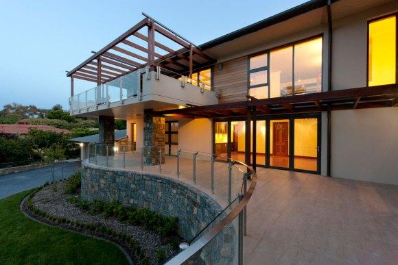 Mugga Way House - North facing patio with deck above