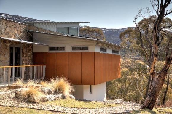 Lake Crackenback house - landscape context with snowy Mountains behind skillion roofs-