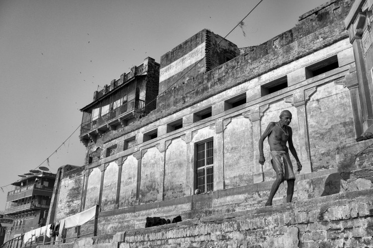 Man Walking Along Ghat Framed Against Wall in Black and White - Varanasi, India - Copyright 2016 Ralph Velasco
