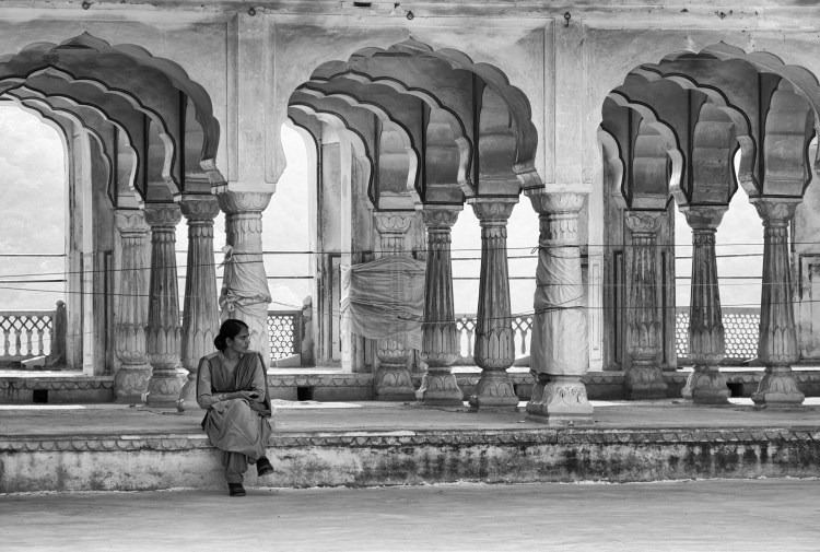 Woman Sitting by Scalloped Arches at Amber Fort - Jaipur, India - Copyright 2016 Ralph Velasco