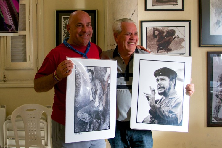 Ralph and Roberto Salas Holding Images of Che - Havana, Cuba - Copyright 2014 Ralph Velasco