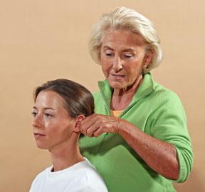 Linda Tellington-Jones using Ear TTouch for people wellness