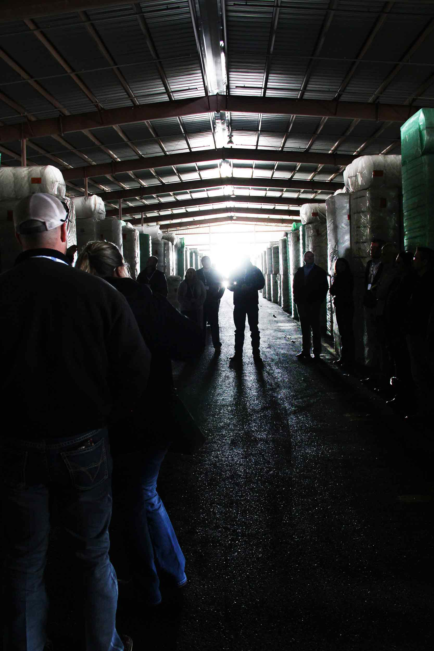 Producers look on during Farmers Cooperative Compress' tour of its cotton warehouses.