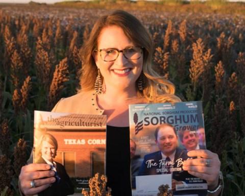 Jennifer Blackburn holds up her magazines