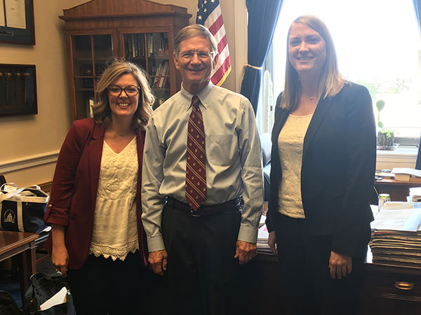 Carmen Fenton (left) and Ashlee Vinyard (right), two Tech alumni, interned in D.C. at the same time and were roommates. Vinyard, Rep. Lamar Smith.