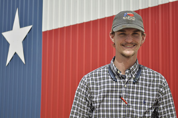 Photo of Kirk Martin in front of his Texas themed barn