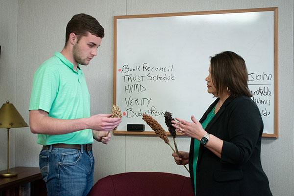 Norma Ritz Johnson talks to student intern.