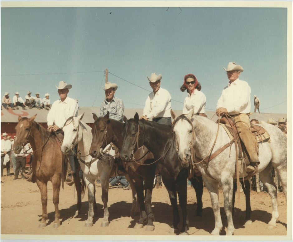 Picture of Mrs. Anne Marion and her cowboys on the ranch.