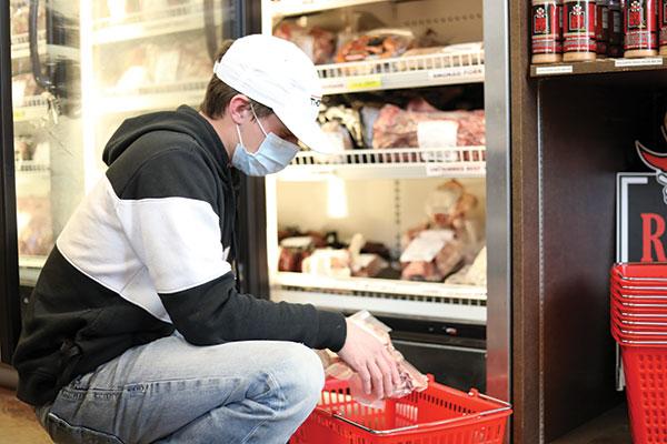 Customer at Raider Red Meats shopping