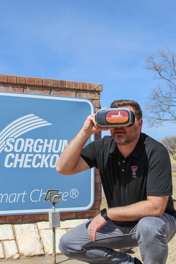 Clint White holding VR glasses