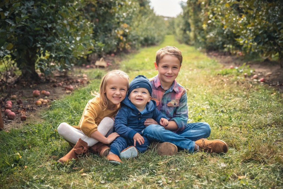 Family Pictures in an apple orchard