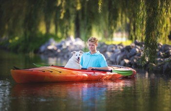 senior picture on old town kayak with dog