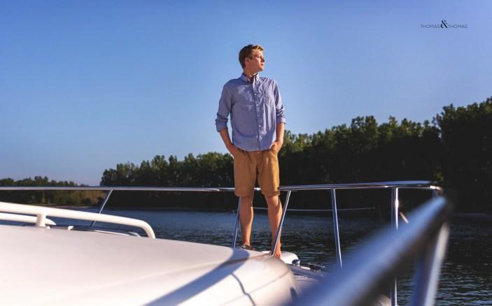 senior photo on bow of boat