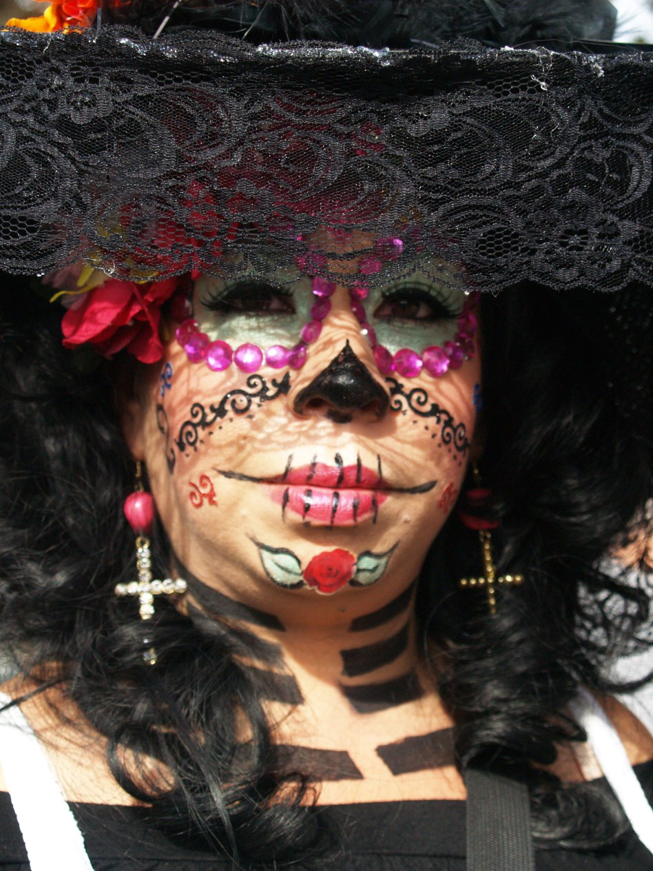 A woman costumed as a catrina - a representation of the dead.