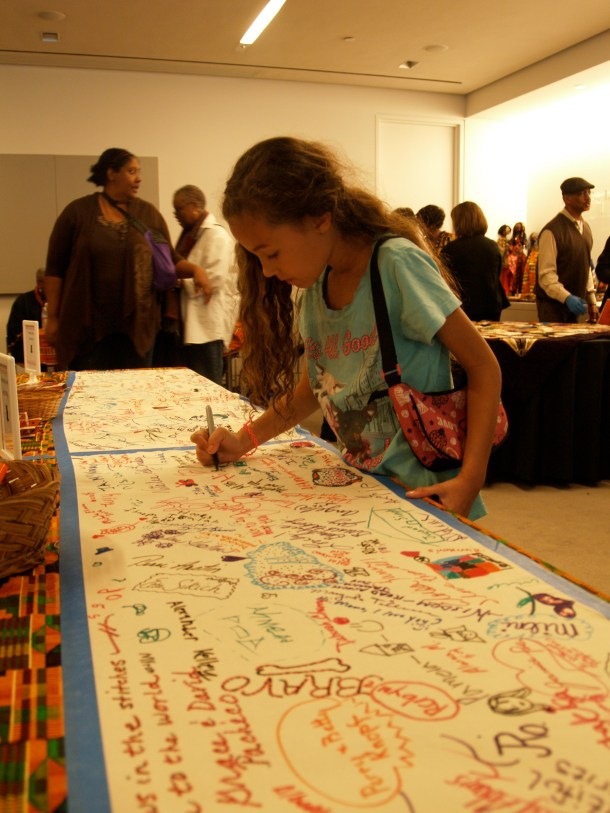 Kids were invited to sign fabric at the Sisters Quilting Collective display.