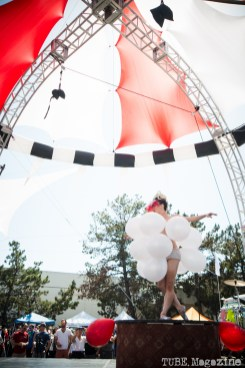 The Vau de Vire Society performing a modern burlesque act which included the popping of balloons wrapped around the performers body until she was left in next to nothing at the 2014 Lagunitas Beer Circus in Petaluma CA. Shown here the villain responsible for popping the balloons. Photo Melissa Uroff