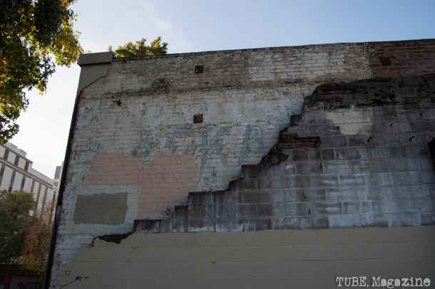 Crumbled cinderblocks reveal the original brick wall on the backside of the former Scientology Center at the corner of 15th and I Streets. Photo M.Hershenow. 2014.