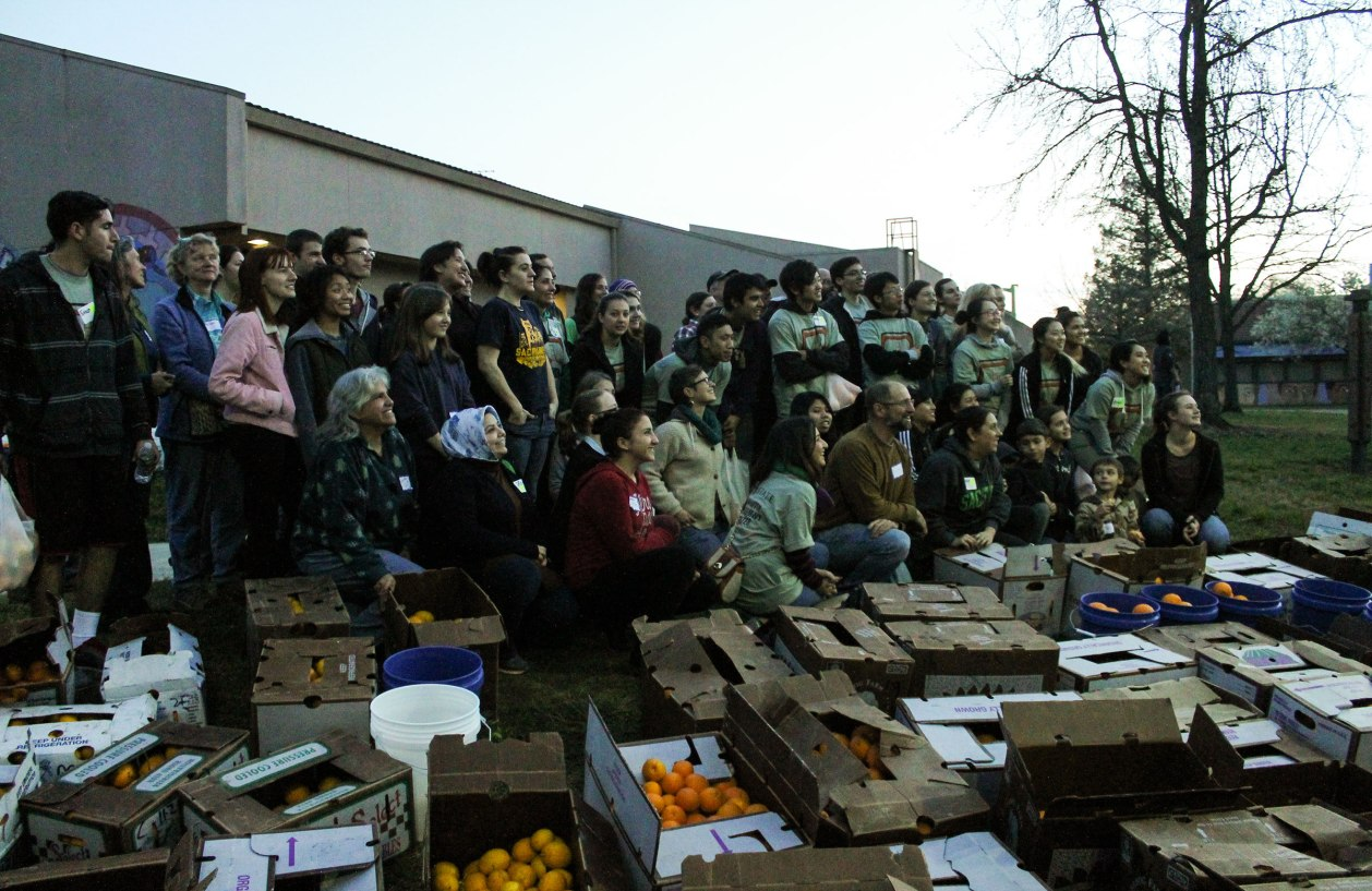 A group photo of some volunteers after the day of fruit picking.