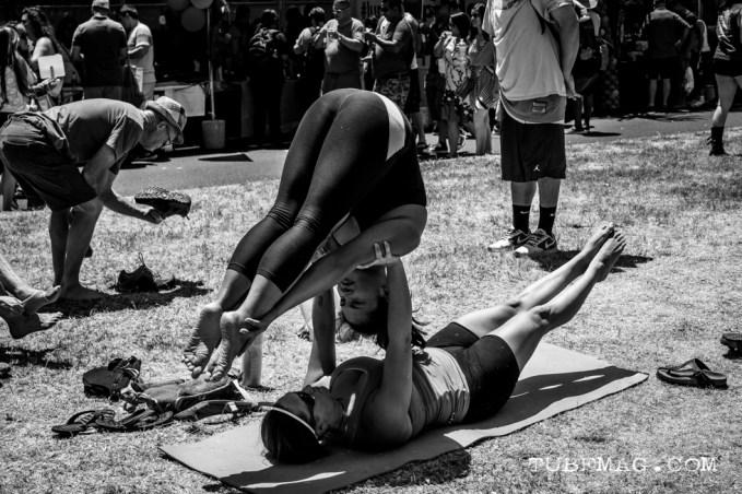 Festival goers performing acroyoga at Sac Pride 2015, Photo Sarah Elliott