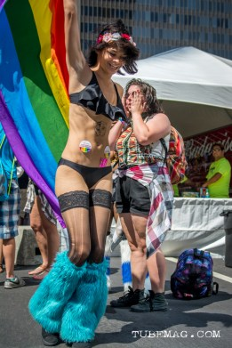 Party Girl dances away Woman hiding under her umbrella from the sweltering heat of the sun at Sac Pride 2015. Sacramento, CA. 2015, Photo Sarah Elliott