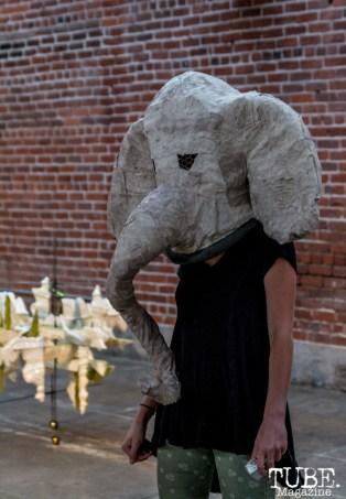 Elephant masked performer looking to hand out a metallic trinket to a lucky guest at Beatnik Studios. Sacramento CA. Photo Sarah Elliott.