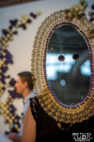 Artist, Tess Gallagher, wearing one of Ortbal's masks at Beatnik Studios in Sacramento CA. Photo Sarah Elliott. 2015