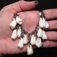 Custom order necklace using 13 real human molars by Jana Miller