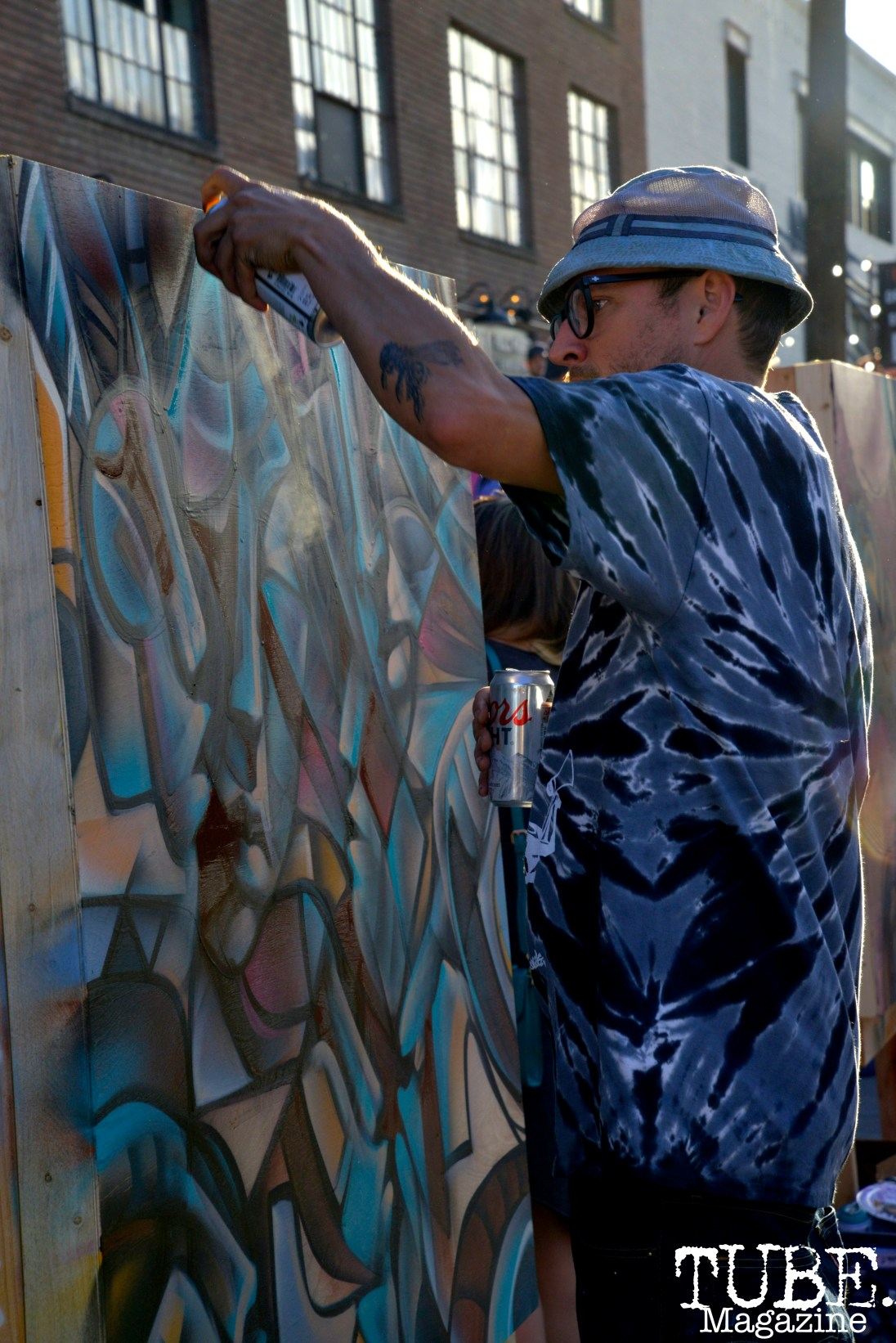 Shaun Burner, owner of 1810 Gallery, live paints at the R Street Block Party in Sacramento, California on Saturday 21, 2016.