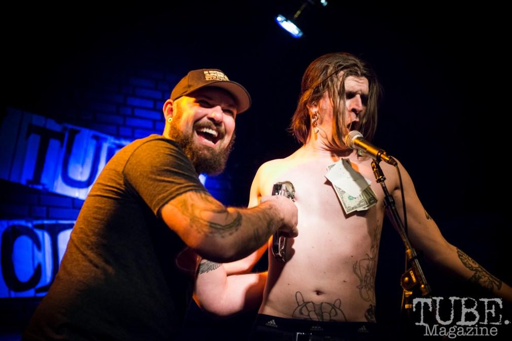 Joe Lowery stapling money to The Displayed Labors Sideshow. TUBE. Circus, Blue Lamp, Sacramento, May 2016. Photo Melissa Uroff