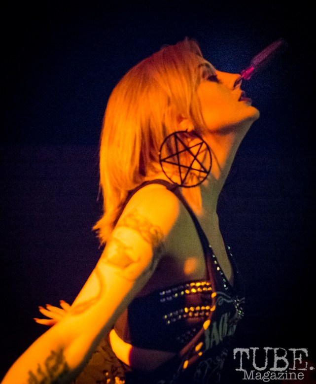 Courtney Crimson of The Displayed Labors Sideshow hammering a screwdriver into her nose. Blue Lamp, TUBE Circus 2016. Photo Melissa Uroff