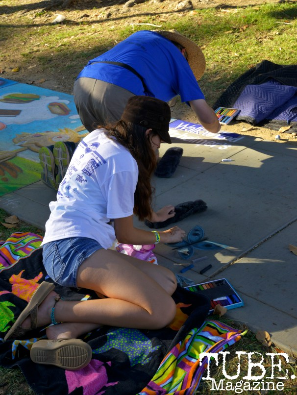 A father and daughter create a chalk piece for A Walk to End Alzheimer's at Chalk It Up in Sacramento, CA, September 4, 2016. Photo Emma Montalbano.