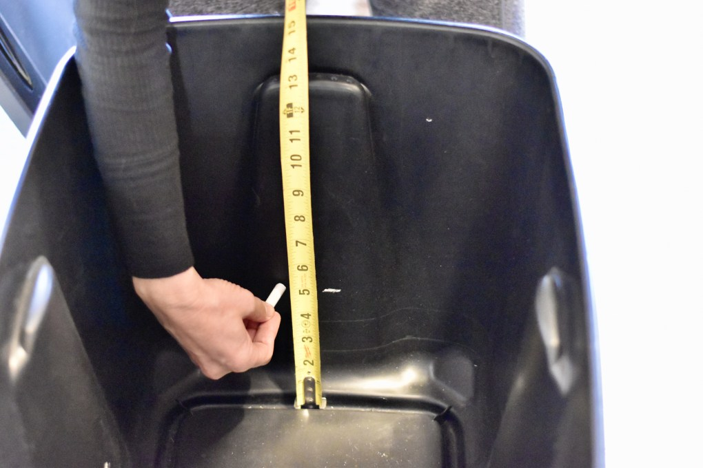 "This shows measuring a 5"" depth with chalk on the bottom of the bin."
