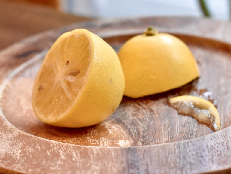 Close up of a lemon, juicy, cut in half