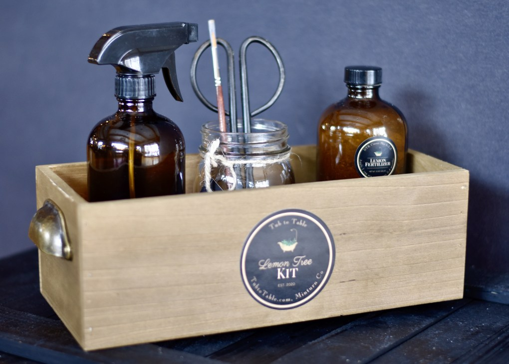 Lemon tree care kit in reclaimed wooden box.