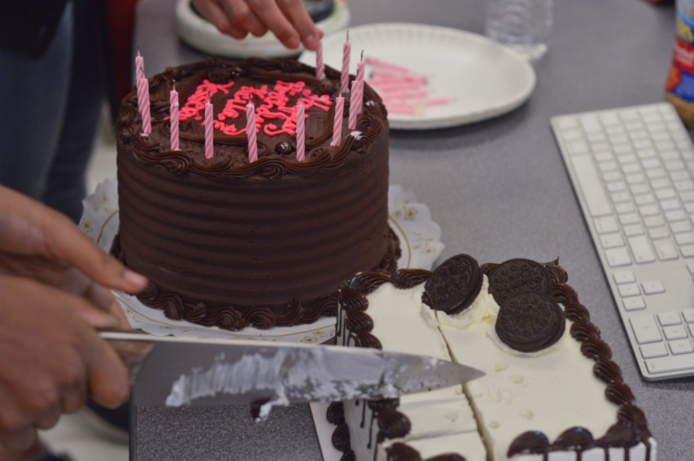 Students indulged in a chocolate cake topped with fudge and an ice cream cake to celebrate two birthdays in the newsroom.