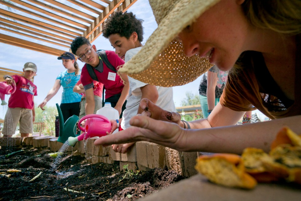 Teenagers from the 4-H Healthy Living Ambassadors program watered the worm bin at the Tucson Farm Village in Tucson on May 27. The program plans to train at least 300 youth this year in farming, nutrition and food preparation.