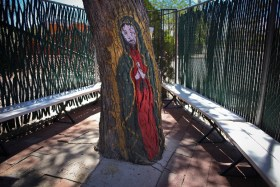 The Lady of Guadalupe painted on a tree outside the Chapel of Our Lord of the Miracles.
