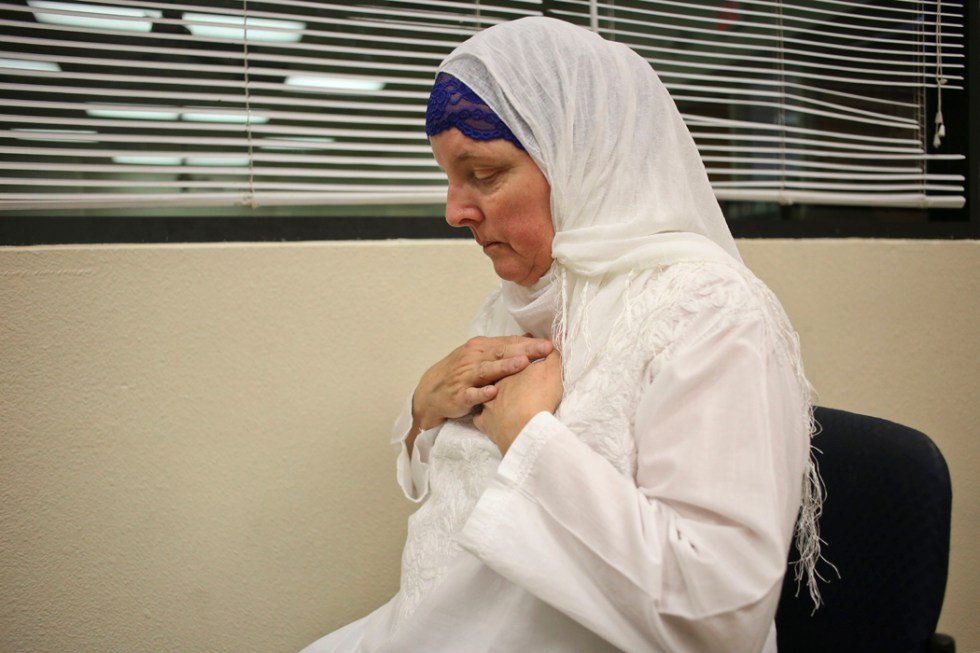 Maryam Mir, 57, converted to Islam 26 years ago. She performed a prayer at the Downtown Islamic Center in Tucson. She said that the Muslim converts living in the West are a bridge between both worlds.